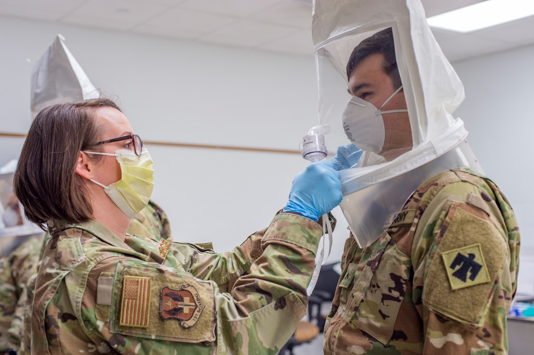 Tech. Sgt. Rebecca Keylon, a bio-environmental engineering technician with the 137th Special Operations Medical Group, Oklahoma Air National Guard, administers a N95 medical mask fit test to Oklahoma Army National Guard Pvt. Connor Boal, a medic with the Oklahoma Army National Guard Medical Detachment, as part of COVID-19 medical response training at the 90th Troop Command Headquarters in Oklahoma City, April 10 - 11. The training, which included presentations by the University of Oklahoma Medical Center and the Oklahoma County Health Department, will prepare Oklahoma Army and Air National Guard medical personnel for potential missions with their civilian counterparts in response to the outbreak of COVID-19 across the state. (Oklahoma National Guard photo by Staff Sgt. Brian Schroeder)