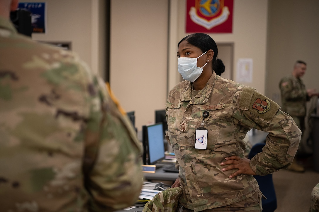 Oklahoma Air National Guard Senior Master Sgt. Scherryl Coulter, a human resources specialist assigned to Joint Force Headquarters - Air Staff, confirms overall numbers and unit assignments of Oklahoma Army and Air National Guardsmen who have been activated by Oklahoma's Governor in response to COVID-19 while working within the Oklahoma Joint Task Force at the Multiagency Coordination Center in Oklahoma City, April 14, 2020. Oklahoma Gov. Kevin Stitt activated 175 additional Oklahoma Army and Air National Guardsmen, April 13, 2020, to aid various missions in support of the state's response to COVID-19. (U.S. Air National Guard photo by Tech. Sgt. Kasey M. Phipps)