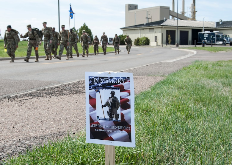 Members of the 341st Security Forces Group participate in a 5K memorial road march during National Police Week May 14, 2019, at Malmstrom Air Force Base, Mont.