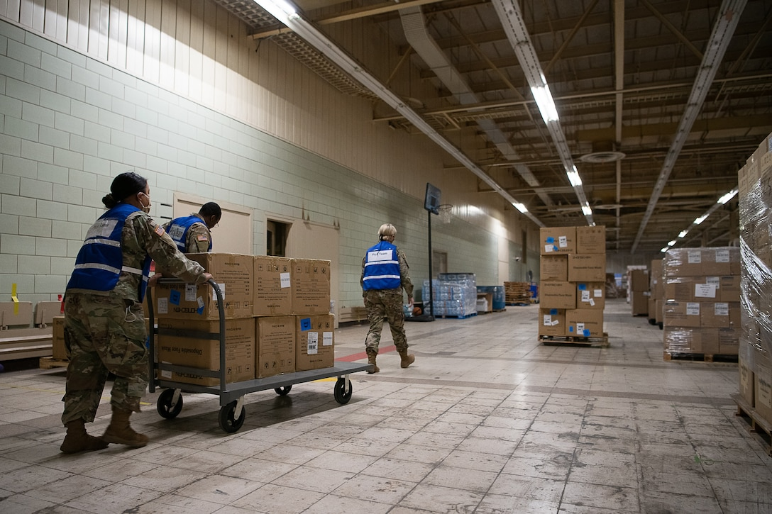 Oklahoma National Guardsmen gather equipment and medical supplies to fulfill orders while assigned to the Strategic National Stockpile warehouse in Oklahoma City, April 17, 2020. The nearly 30 Guardsmen assigned to the site — partnered with state agencies to include the Oklahoma Department of Emergency Management, Oklahoma Department of Public Safety, Oklahoma Department of Transportation, Oklahoma Office of Homeland Security and the Oklahoma Department of Corrections — help fulfill, secure and transport the orders to facilities within the 11 identified COVID-19 regional health administration regions throughout Oklahoma as part of the State's whole-of-government response to the pandemic. (U.S. Air National Guard photo by Tech. Sgt. Kasey Phipps)