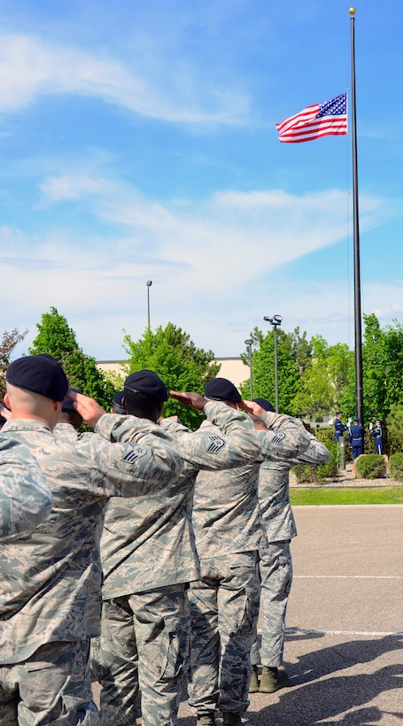 Airmen with the 341st Security Forces Group salute during a retreat ceremony May 16, 2016, at Malmstrom Air Force Base, Mont.