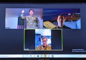 Lt. Col. Sharon Ellis, 445th Aeromedical Evacuation Squadron flight nurse, administers the Oath of Enlistment virtually to Staff Sgt. Logan Wild, 445th AES aeromedical evacuation technician as he re-enlists May 4, 2020. Master Sgt. Eric Riehle, 445th AES career advisor, witnesses via video conferencing  Ellis is Wild's supervisor and resides in Utah, while Wild lives in Columbus, Ohio.