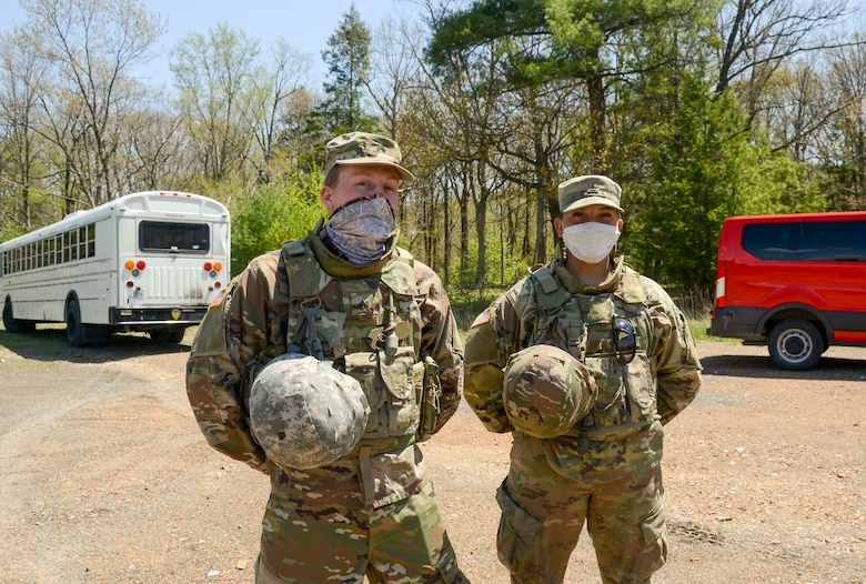 Two Pennsylvania National Guard soldiers stopped to render first aide to a motorcycle crash victim along Interstate 78 near Fort Indiantown Gap May 1.