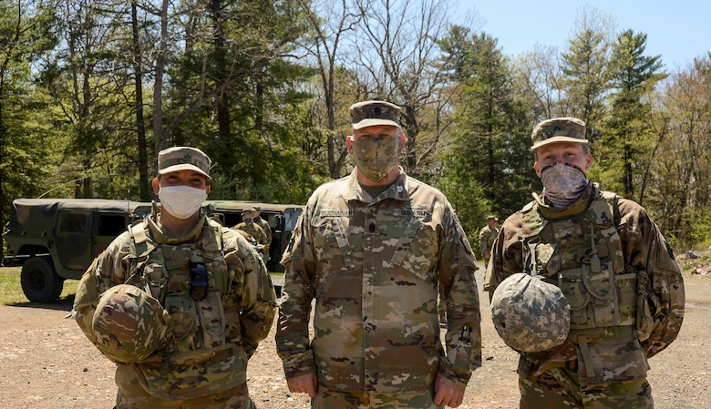 Command Sgt. Maj. Harry Buchanan III, the Pennsylvania National Guard's senior enlisted leader, coined two Pennsylvania National Guard soldiers May 7 who stopped to render first aide to a motorcycle crash victim along Interstate 78 near Fort Indiantown Gap May 1.