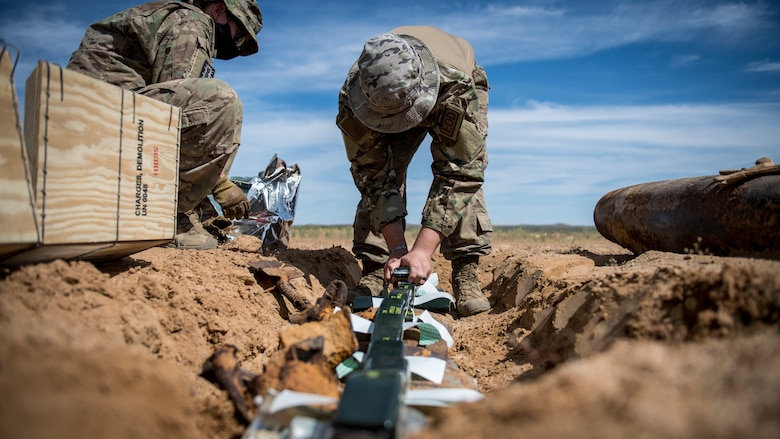 Members of the Explosive Ordnance Disposal unit, 812th Civil Engineer Squadron, 412th Test Wing, prepare unexploded ordnance and training munitions for demolition at the Precision Impact Range Area at Edwards Air Force Base, California, May 7. The 412th Test Wing uses the PIRA to conduct weapons and payload drops for flight tests. (Air Force photo by Giancarlo Casem)