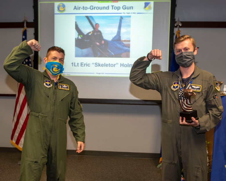 Lt. Col. Jeffrey Shulman, 311th Fighter Squadron commander, presents the Air-to-Ground award to 1st Lt. Eric Holm, 311th Fighter Squadron Basic Course graduate, during the graduation of B-course Class 19-DBH, May 8, 2020, on Holloman Air Force Base, N.M. Twelve B-course students graduated and will be reassigned to operational flying units throughout the Combat Air Force. (U.S. Air Force photo by Staff Sgt. Christine Groening)