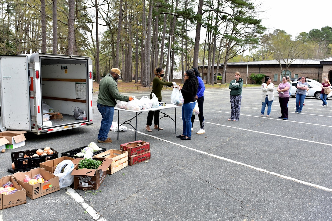 Customers pick-up produce during a bi-monthly produce run at Seymour Johnson Air Force Base, N.C. on March 22, 2020.