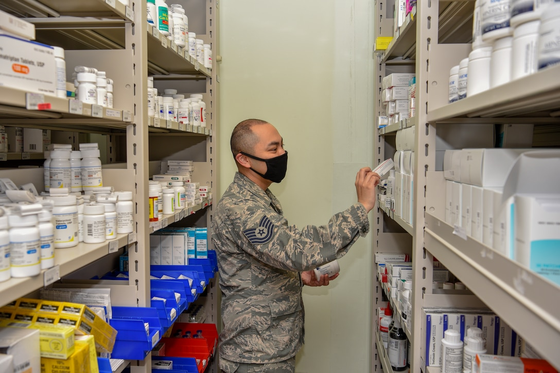 U.S. Air Force Tech. Sgt. Tyrone Rocha, 8th Medical Support Squadron NCO in charge of pharmaceutical services, checks inventory at Kunsan Air Base, Republic of Korea, May 6, 2020. The pharmacy team provides medical support to more than 2,500 members of the Wolf Pack to keep them fit to fight. (U.S. Air Force photo by Tech. Sgt. Joshua Arends)