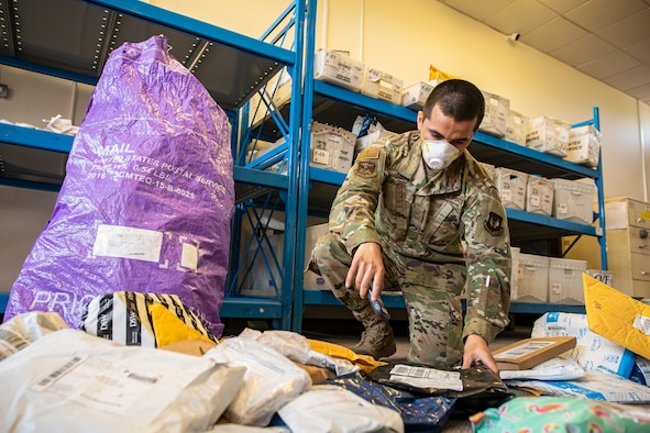 Senior Airman Daniel Rangel, 423d Force Support Squadron postal clerk, scans in packages, at RAF Alconbury, England on May 7, 2020.The 423d FSS postal team has continued to maintain operational readiness during COVID-19 as part of the central postal distribution hub for U.S. service members and their families stationed in the United Kingdom. (U.S. Air Force photo by Senior Airman Eugene Oliver)