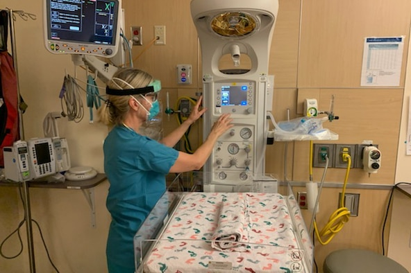 Julia Kitterman, a Neonatal Intensive Care Unit nurse at St. Peters Hospital in Olympia, Wa., prepares a work station during her shift May 11, 2020. The NICU is respoinsible for newborn babies that have certain difficulties and need extra care before they can go home. (U.S. Air Force photo by Staff Sgt. Luke Kitterman)