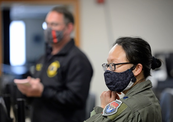 Lt. Col. Hui Ling Li, Wright-Patterson Air Force Base COVID-19 incident commander and 88th Medical Group chief of Aerospace Medicine, and Jacob King, left, 88th Air Base Wing Incident Command Center fire chief, brief 88 ABW Incident Command Center personnel at Wright-Patterson Air Force Base, Ohio, May 5, 2020. (U.S. Air Force photo/Ty Greenlees)
