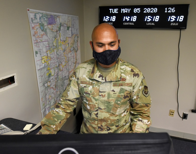 Tech. Sgt. Jeremy Ordiales, 88th Air Base Wing Incident Command Center section chief, admin cell, listens to a daily conference call with Col. Thomas P. Sherman, 88 ABW commander, while monitoring the COVID-19 pandemic at Wright-Patterson Air Force Base, Ohio, May 5, 2020. (U.S. Air Force photo/Ty Greenlees)