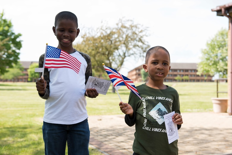 Allen and Keeghan Ransaw hold a U.S. flag and a U.K. flag during the Victory in Europe Day Scavenger Hunt at RAF Alconbury, England May 8, 2020. While keeping with COVID-19 physical distancing guidelines, the self-guided walking tour on base was geared toward teaching children and families the events that led to the end of World War II as they exercised. (U.S. Air Force photo by Airman 1st Class Jennifer Zima)