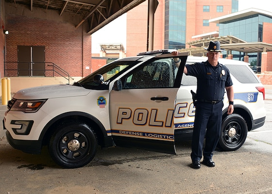 Lt. Mark Bowen stands by his police car