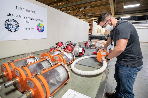Kaimana Lutey, a fabric worker with Shop 64, Sail Loft prepares to test the negative pressure air handling system for a biocontainment system May 11, 2020 in the Building 460, at Puget Sound Naval Shipyard & Intermediate Maintenance Facility in Bremerton, Washington.