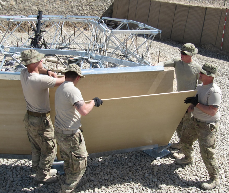 US soldiers work on constructing a structures.