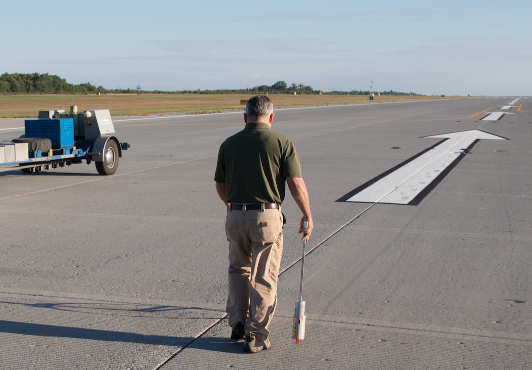 A researcher works on inspecting an airfield.