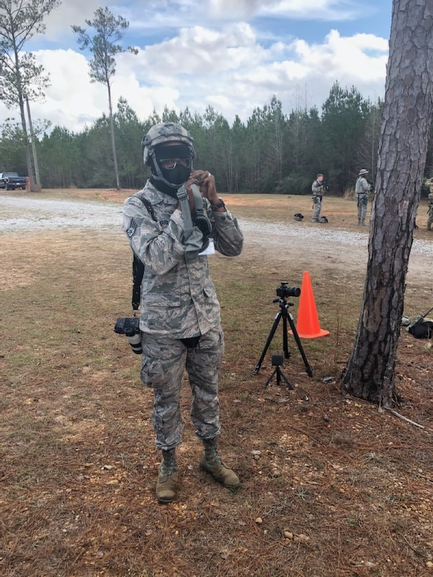 Staff Sgt. Shelton Sherrill, 403rd Wing Public Affairs specialist, dons his Kevlar helmet during the field exercise Operation Southern Comfort Jan. 16, 2020, at Camp Shelby, Mississippi. Sherrill said that being a traditional reservist in the PA career field enables him to be creative with his work and it serves as an outlet to relieve stress and brings joy.  (U.S. Air Force photo by Maj. Jonathan Brady)
