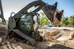 A U.S. Marine operates a skid steer during a command post exercise at Marine Corps Base Camp Lejeune, North Carolina, April 8.