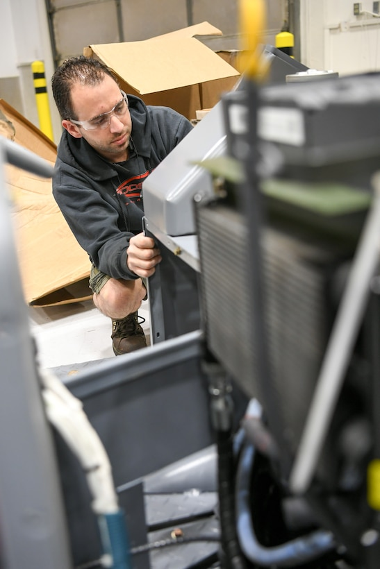 Kevin Watkins, 309th Electronics Maintenance Group, replaces a panel on a MJ-1 jammer April 29, 2020, at Hill Air Force Base, Utah. The 309th EMXG in the Ogden Air Logistics Complex provides repair and overhaul for exchangeable assets for a multitude of systems on a wide assortment of Air Force weapons systems including fighter aircraft, intercontinental ballistic missiles, powered aerospace ground equipment, tactical shelters, as well as refurbishment of radomes worldwide. (U.S. Air Force photo by Cynthia Griggs)
