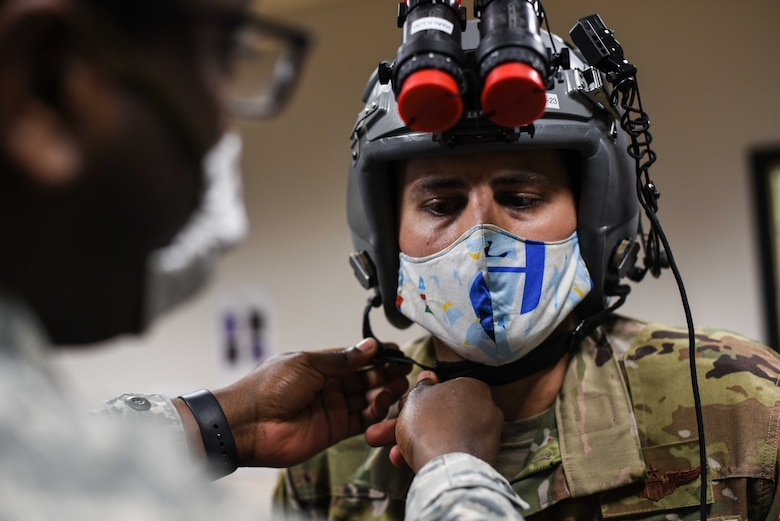 Maj. Tony Gorry, 344th Air Refueling Squadron and chief of group training, has his helmet fitted by Airman 1st Class Trezvon Miers, 22nd Operations Support Squadron aircrew flight equipment journeyman, April 21, 2020, at McConnell Air Force Base, Kansas. The crew prepared to execute the Air Force's first night vision operational training mission on the KC-46A Pegasus. (U.S. Air Force photo by Senior Airman Alexi Bosarge)