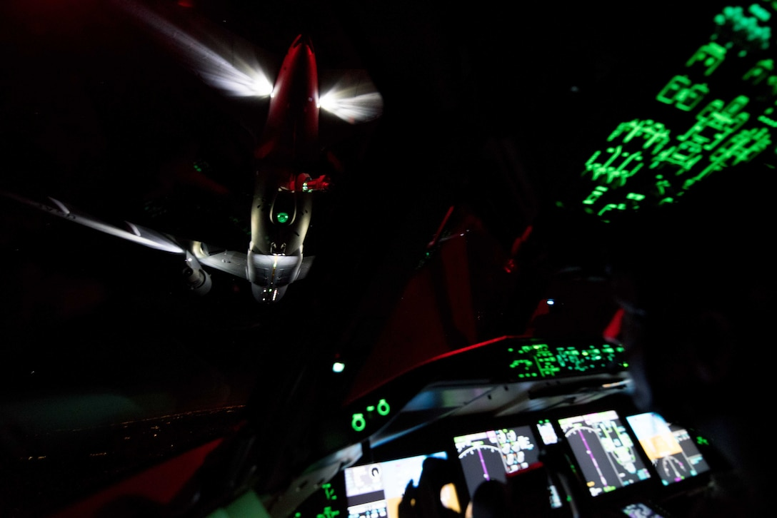 A 344th Air Refueling Squadron KC-46A Pegasus receives fuel from a 924th ARS KC-46 April 23, 2020. Aircrews practiced nighttime aerial refueling operations on the way to North Auxiliary Airfield, South Carolina, in conjunction with tactical takeoffs and landings using night vision goggles. (U.S. Air Force photo by Senior Airman Alexi Bosarge)