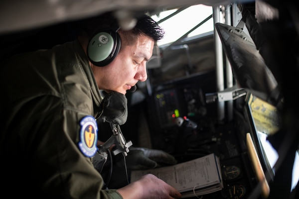 Senior Airman David Rodriquez, 351st Air Refueling Squadron boom operator, reviews a checklist prior to a flight supporting a strategic bomber mission at RAF Mildenhall, England, May 7, 2020. Strategic bomber missions familiarize aircrew with air bases and operations in different Geographic Combatant Command's areas of operations.
