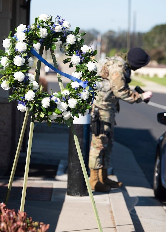 A wreath sits at the main gate in honor of Police Week May 11, 2020, at Vandenberg Air Force Base, Calif. In celebration of National Police Week, which is celebrated in recognition of law enforcement officers who have lost their lives in the line of duty, a wreath was placed at the front gate and the Base Exchange. A memorial with a book of fallen defenders was also displayed in the Exchange to honor their stories and history. (U.S. Air Force photo by Senior Airman Hanah Abercrombie)