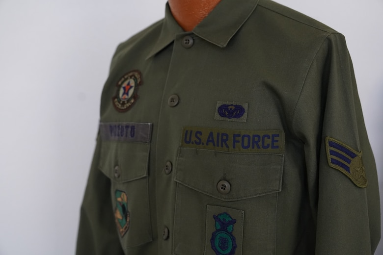 A Cotton Sateen Utility uniform owned by Chief Master Sgt. David Pizzuto, 81st Training Wing command chief, is displayed inside of the Levitow Training Support Facility at Keesler Air Force Base, Mississippi, May 6, 2020. Pizzuto, who is slated to retire this month, has served for 37 years and has worn every uniform the Air Force has ever known. (U.S. Air Force photo by Airman 1st Class Spencer Tobler)