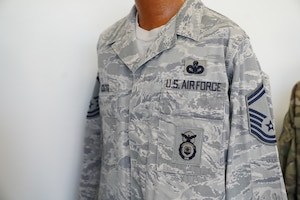 An Airman Battle Uniform owned by Chief Master Sgt. David Pizzuto, 81st Training Wing command chief, is displayed inside of the Levitow Training Support Facility at Keesler Air Force Base, Mississippi, May 6, 2020. Pizzuto, who is slated to retire this month, has served for 37 years and has worn every uniform the Air Force has ever known. (U.S. Air Force photo by Airman 1st Class Spencer Tobler)