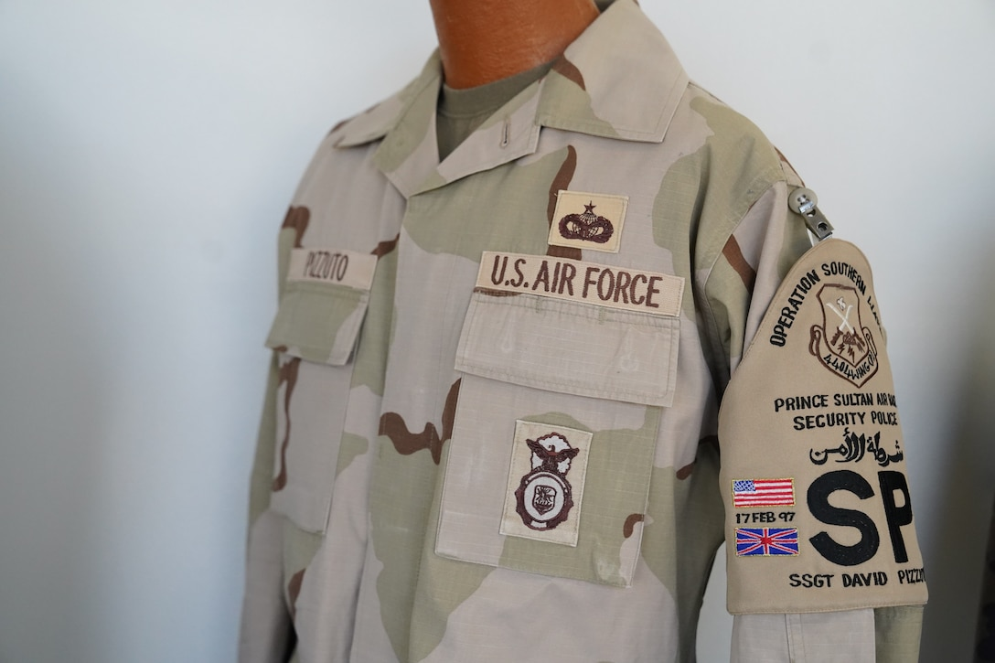 A Desert Camouflage Uniform owned by Chief Master Sgt. David Pizzuto, 81st Training Wing command chief, is displayed inside of the Levitow Training Support Facility at Keesler Air Force Base, Mississippi, May 6, 2020. Pizzuto, who is slated to retire this month, has served for 37 years and has worn every uniform the Air Force has ever known. (U.S. Air Force photo by Airman 1st Class Spencer Tobler)