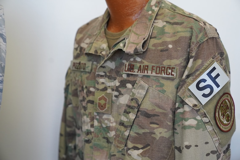 An Operational Camouflage Pattern uniform owned by Chief Master Sgt. David Pizzuto, 81st Training Wing command chief, is displayed inside of the Levitow Training Support Facility at Keesler Air Force Base, Mississippi, May 6, 2020. Pizzuto, who is slated to retire this month, has served for 37 years and has worn every uniform the Air Force has ever known. (U.S. Air Force photo by Airman 1st Class Spencer Tobler)