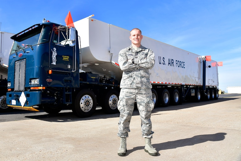Capt. Scott A. Jensen, Ogden Air Logistics Complex, stands in front of a transporter erector vehicle.