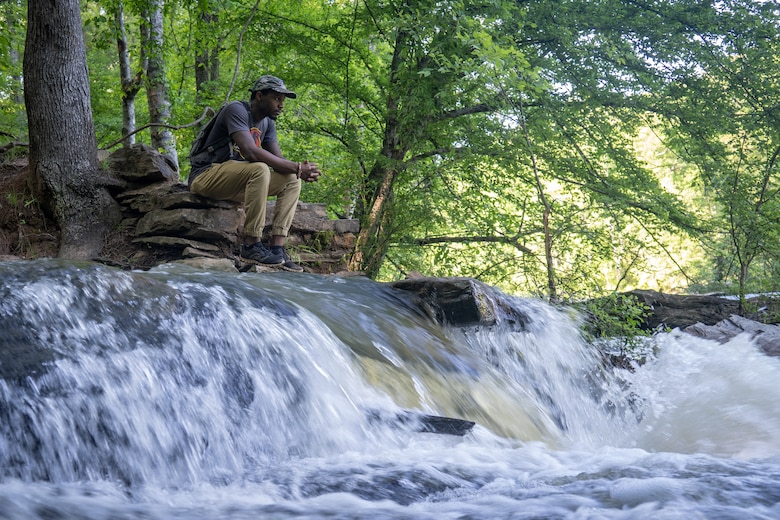 Shelton Sherrill watches the water flow across the rocks. (Courtesy photo by Shelton Sherrill)