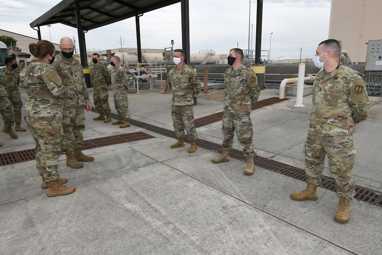 Photo shows the general talking to a line of Airmen.