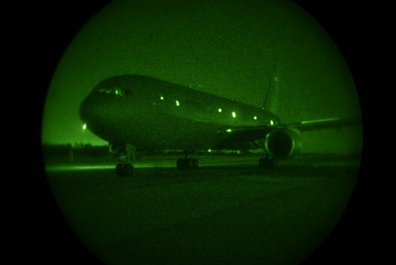 A KC-46A Pegasus parks after performing multiple flight maneuvers April 30, 2020, at North Auxiliary Airfield, South Carolina. The airfield is designed to test airframes and train aircrew in low-light environments. The testing data will be used to advance research in aerial refueling and night flying operations using night vision goggles. (U.S. Air Force photo by Airman 1st Class Marc A. Garcia)