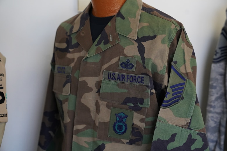 A battle dress uniform owned by Chief Master Sgt. David Pizzuto, 81st Training Wing command chief, is displayed inside of the Levitow Training Support Facility at Keesler Air Force Base, Mississippi, May 6, 2020. Pizzuto, who is slated to retire this month, has served for 37 years and has worn every uniform the Air Force has ever known. (U.S. Air Force photo by Airman 1st Class Spencer Tobler)