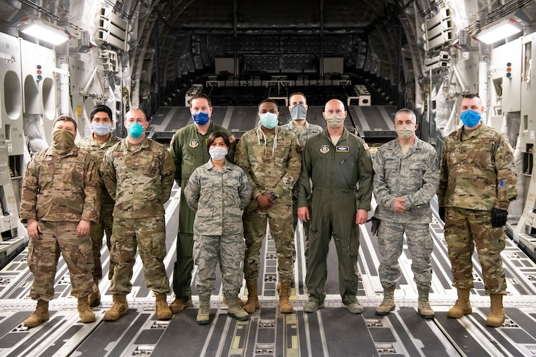 Military members from six units across the U.S., which comprise their Transport Isolation System mission team, pose for a group photo in a C-17 Globemaster III at Dover Air Force Base, Delaware, May 5, 2020. The personnel are assigned to two Transportation Isolation Systems that will remain at Dover AFB as long as required as part of the government's response to COVID-19. (U.S. Air Force photo by Senior Airman Christopher Quail)