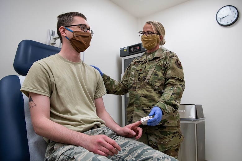 U.S. Air Force Maj. Jesse Walsh, a clinical nurse assigned to the 27th Special Operations Medical Group, chats with Airman 1st Class Brandon O'Bryant, a medical technician assigned to the 27 SOMDG, during training at Cannon Air Force Base, New Mexico, May 6, 2020. (U.S. Air Force photo by Senior Airman Maxwell Daigle)