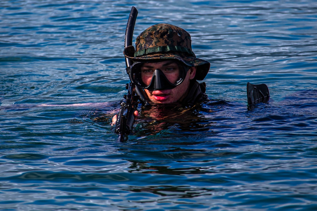 A U.S. Marine swims ashore during an amphibious assault exercise on Marine Corps Base Hawaii, April 28.