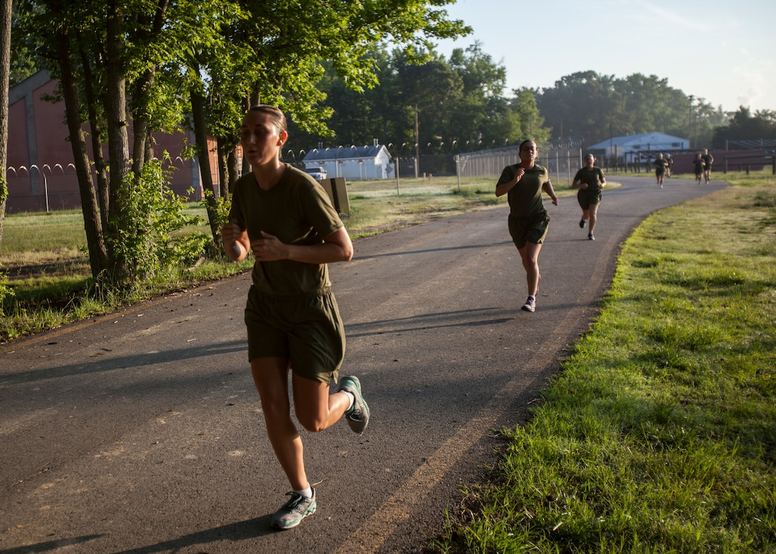 Candidates in Officer Candidate School, conduct the Physical Fitness Test aboard Marine Corps Base Quantico, Va., June 1.