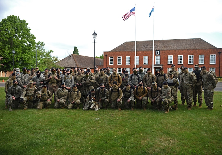 Members of the 100th Security Forces Squadron pose for a photo prior to their memorial ruck march to commemorate National Police Week 2020 at RAF Mildenhall, England, May 13, 2020. National Police Week is an observance in the United States which pays tribute to local, state and federal officers who've died or who've been disabled in the line of duty. (U.S. Air Force photo by Senior Airman Brandon Esau)