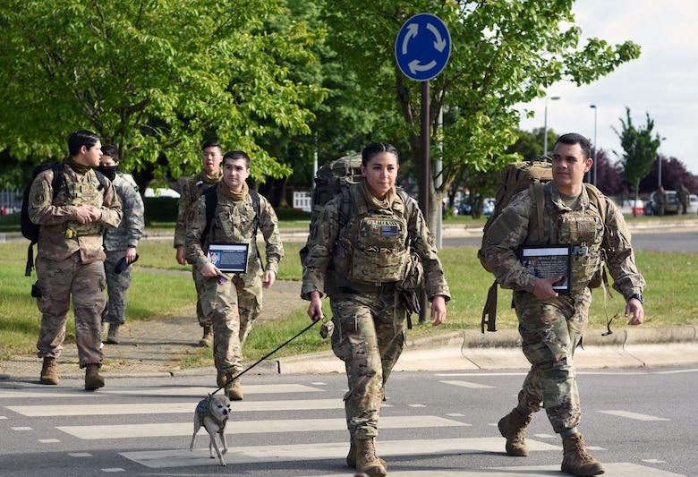 Airmen from the 100th Security Forces Squadron march during the 100th SFS Memorial Ruck March to commemorate National Police Week at RAF Mildenhall, England, May 13, 2020. National Police Week is an observance in the United States which pays tribute to local, state and federal officers who've died or who've been disabled in the line of duty. (U.S. Air Force photo by Senior Airman Brandon Esau)