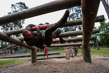 A recruit with Alpha Company, 1st Recruit Training Battalion, navigates an obstacle  during the Confidence Course aboard Marine Corps Recruit Depot Parris Island, S.C., Mar. 31, 2020. The Confidence Course is composed of various obstacles that both physically and mentally challenge recruits. (U.S. Marine Corps photo by Lance Cpl. Christopher McMurry)