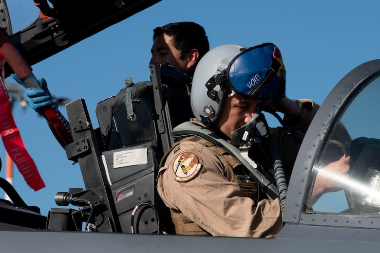A 492nd Fighter Squadron pilot conducts pre-flight preparations before taking off from Royal Air Force Lakenheath, England, May 6, 2020. The 492nd FS is the first fighter squadron from the Liberty Wing to deploy since the start of the COVID-19 pandemic. (U.S. Air Force photo by Senior Airman Christopher S. Sparks)