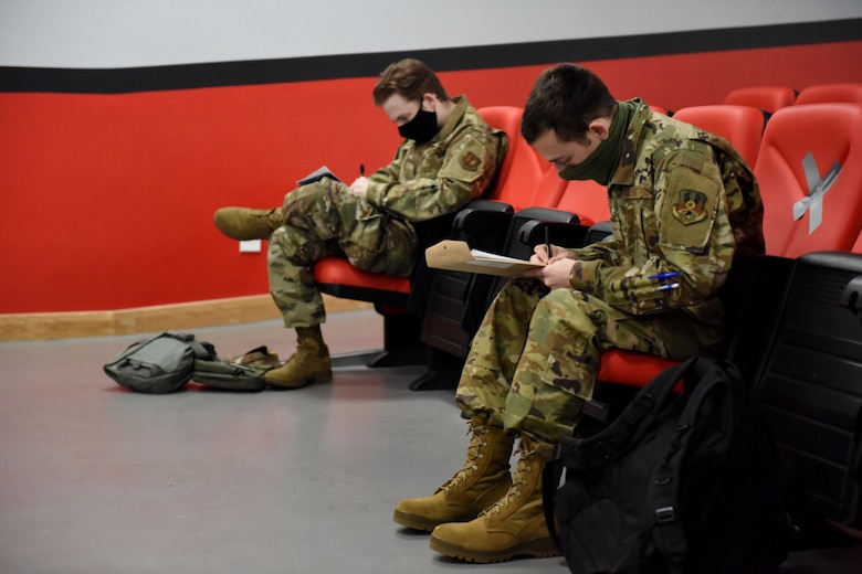 Two Airmen assigned to the 492nd Fighter Squadron maintain social distancing while completing pre-deployment line tasks at Royal Air Force Lakenheath, England, May 6, 2020. F-15E Strike Eagles and Airmen from the 492nd FS and supporting units across the 48th Fighter Wing are currently deployed in support of Operation Inherent Resolve. (U.S. Air Force photo by Senior Airman Christopher S. Sparks)