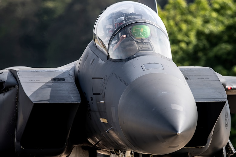 An F-15E Strike Eagle assigned to the 492nd Fighter Squadron prepares to take off from Royal Air Force Lakenheath, England, May 7, 2020. The 492nd FS is the first of the three fighter squadrons at the Liberty Wing to deploy during the current COVID-19 pandemic. (U.S. Air Force photo by Airman 1st Class Jessi Monte)