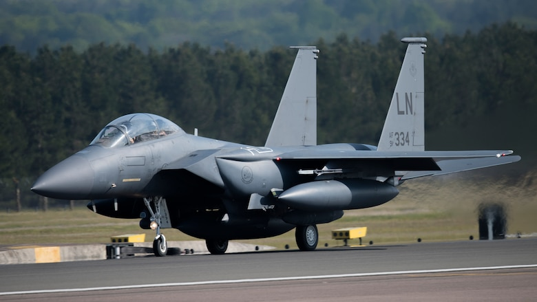 An F-15E Strike Eagle assigned to the 492nd Fighter Squadron takes off from Royal Air Force Lakenheath, England, May 7, 2020. The 492nd FS is the first of the three fighter squadrons at the Liberty Wing to deploy during the current COVID-19 pandemic. (U.S. Air Force photo by Airman 1st Class Jessi Monte)