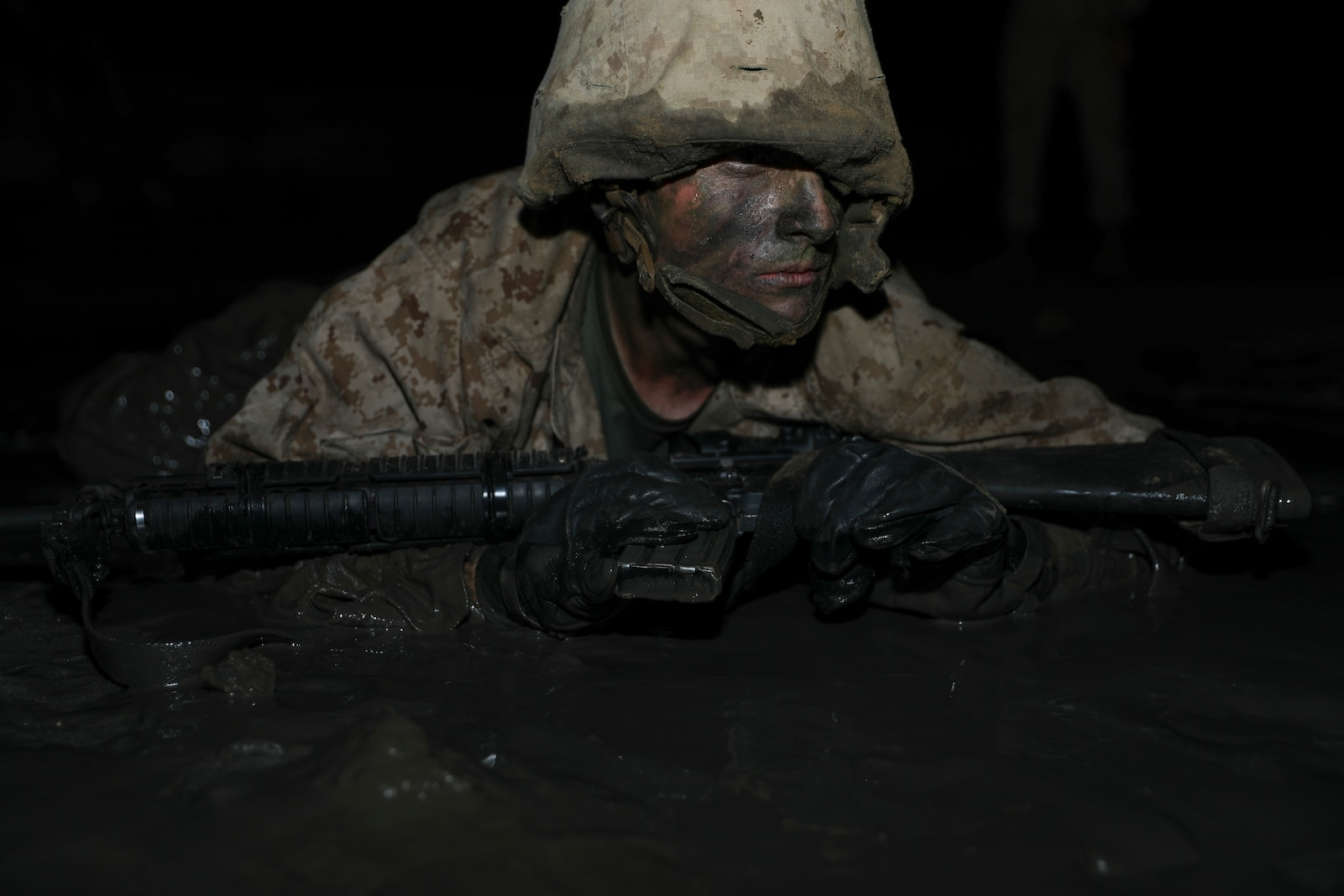 A recruit with Charlie Company, 1st Recruit Training Battalion, advances in a simulated battle during the Crucible aboard Marine Corps Depot Parris Island, Mar. 26, 2020. The Crucible is a 54-hour culminating event that requires recruits to work as a unit to overcome challenges.(U.S. Marine Corps photo by Lance Cpl. Ryan Hageali)
