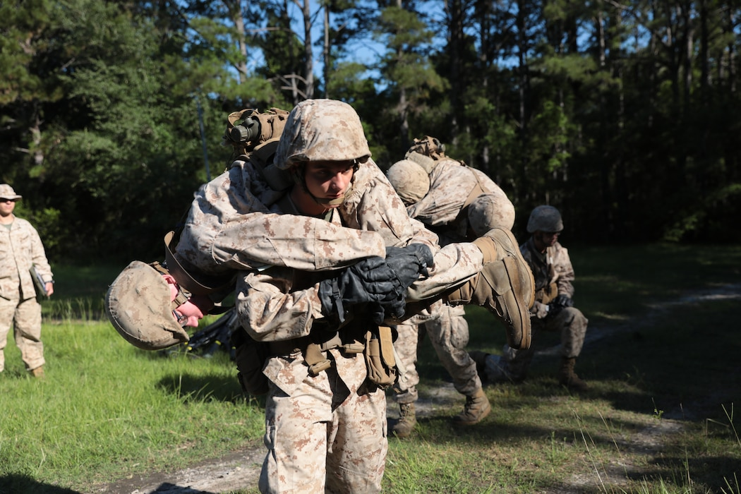 Recruits with Hotel Company, 2nd Recruit Training Battalion, complete the Leadership Reaction Course during the Crucible on Marine Corps Recruit Depot Parris Island, S.C., May 7, 2020. The obstacle course challenges recruits to work together as a team and overcome obstacles. (U.S. Marine Corps photo by Lance Cpl. Devin Darden)